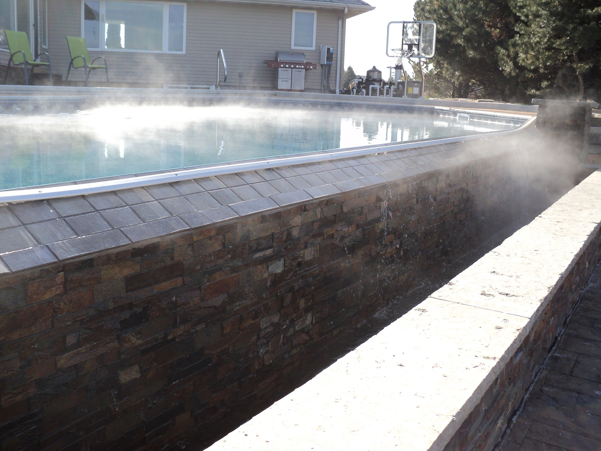Vanishing edge in-ground pool installed by Spring's Pools and Spas