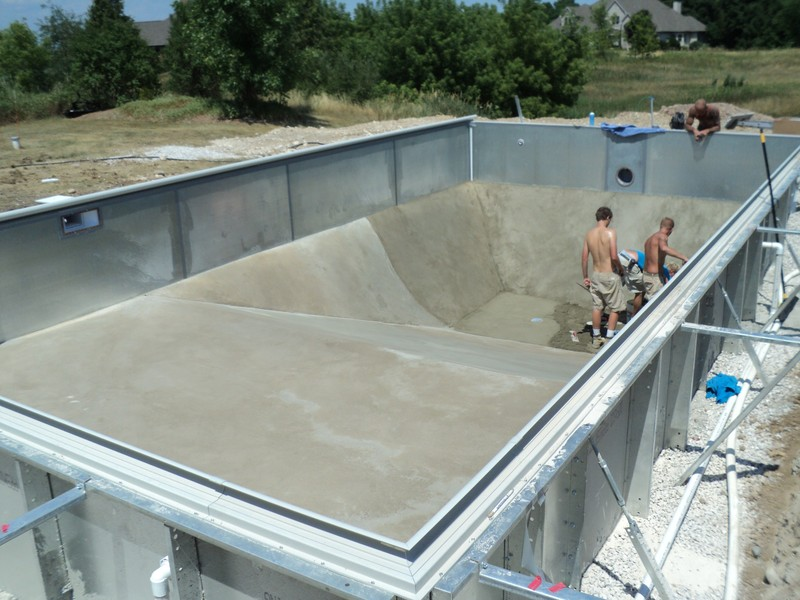 In ground pool construction process spring 39 s pools and spas for Vermiculite swimming pool base