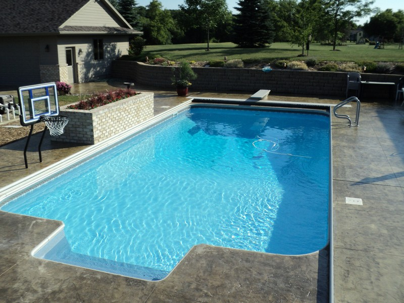 Landscaping and in-ground pool installed by Spring's Pools and Spas