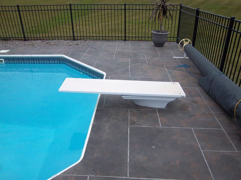 Springu0027s Pools U0026 Spas Can Permanently Cover Up Surface Imperfections In  Existing Concrete, Or Turn A Plain Jane Slab From Drab To Fab.